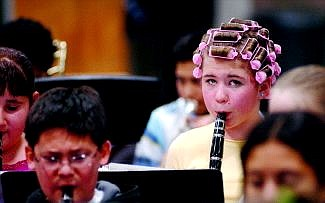 Rick Gunn/Nevada Appeal Haley Marriot, 11, of Eagle Valley Middle School was dressed in pajamas and curlers for this year's practice of Band-o-rama Wednesday morning. The all-school ensemble struck up their tune at 7 p.m. that night.