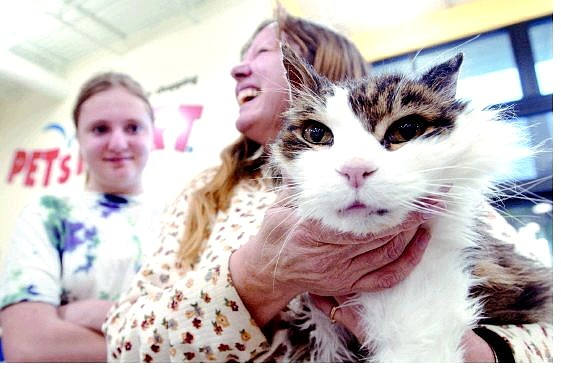 Rick Gunn/Nevada Appeal Robert, the 19-year-old cat, was reunited with his former owner Janet Howard and her daughter, Elizabeth, Wednesday at the PetSmart in Carson City.