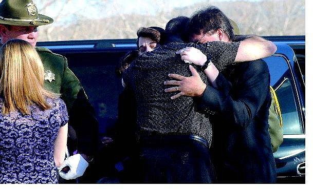 Rick Gunn/Nevada Appeal Matt and Lynette Putzer receive a conciliatory hug from a friend upon arriving at their 10-year-old son's memorial service at Carson Middle School. Hundreds of people attended the service for Brandon Matthew Putzer on Saturday.