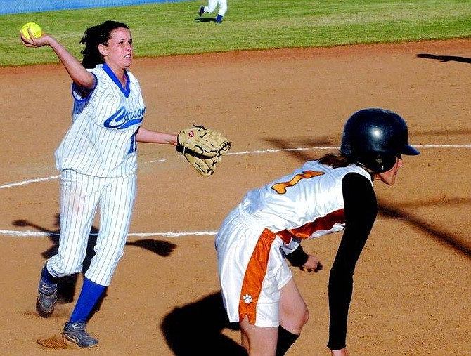 Rick Gunn/Nevada Appeal Mandy Carver throw-out Douglas' Val smith at home base Tuesday at CHS.