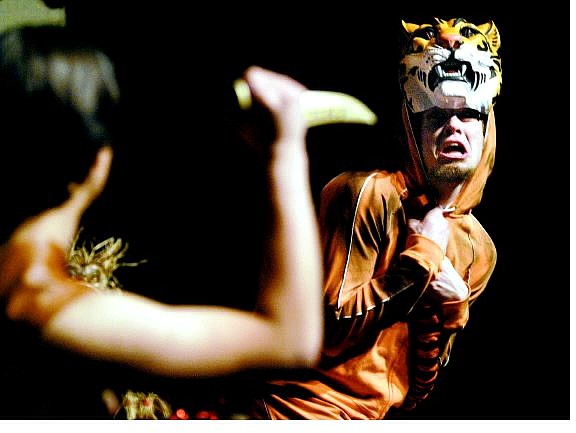 "Cathleen Allison/Nevada Appeal Mark Hernandez as Mowgli and Jer James as Shere Khan rehearse for ""The Jungle Book"" at the Community Center on Monday night."