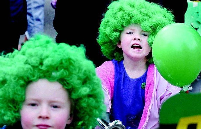 Rick Gunn/Nevada Appeal Cassie Mitchell, 3, smiles during the annual Kinderland Nursery School's St. Patrick's Day parade Thursday morning. She was in costume with her brother Jared Mitchell, 5.