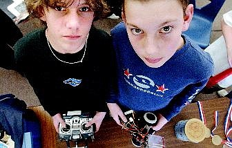 Seventh-graders Wes Deitlein, left, and Robbie Ardinger hold their robo-billiards, which took first place in at the Science Olympiad in Las Vegas recently.    Rick Gunn Nevada Appeal