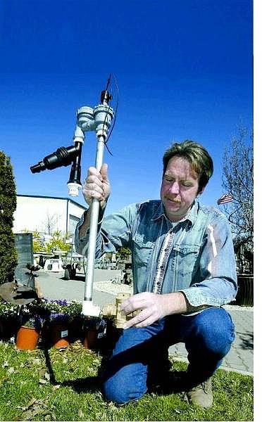 Cathleen Allison/Nevada Appeal David Ruf, owner of Greenhouse Garden Center, talks about sprinkler assemblies Monday morning at center.