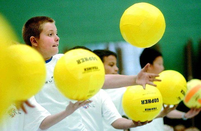 Rick Gunn/Nevada Appeal Jesse Cowdell, 9, practices his volleyball serve during the after-school intrarmural vollleyball club at Mark Twain Elementary School Tuesday.