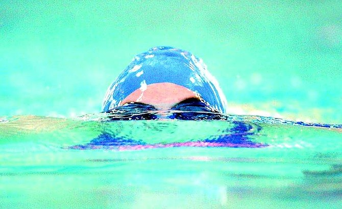 BRAD HORN/Nevada Appeal Carson freshman Carrie Lynn competes in the breaststroke in the 200 meter individual medely at the Carson Aquatic Center Thursday.