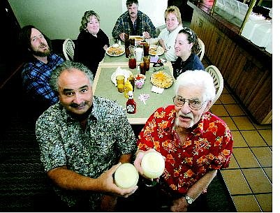 BRAD HORN/Nevada Appeal Tequila Dan's owners from left Dan Hague and Alfred Verschell toast margaritas with a table of loyal customers Thursday afternoon. The customers from right counterclockwise are Arlana Zimmerman, 16, Shari Hobson, Cal Hobson, Sandra Zimmerman and Lee Zimmerman.