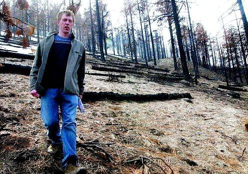 Rick Gunn/Nevada Appeal Carson City Life Scout Mike Otterstrom walks down the steep banks of the Waterfall fire burn area above his Lakeview neighborhood Tuesday. Otterstrom will plant 1,000 Jeffery pines on 50 acres as part of his Eagle Scout project in mid-April.