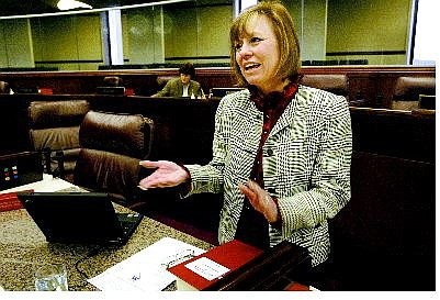 Cathleen Allison/Nevada Appeal Nevada Assemblywoman Sharron Angle, R-Reno, talks on the Assembly floor Friday at the Legislature in Carson City, after lawmakers passed a bill that would provide relief from soaring property taxes. Angle was the sole vote against the bill.