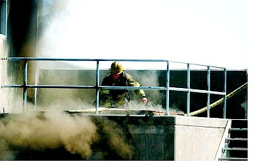 An unidentified firefigher trains at Carson City fire station No. 2 on Thursday.  BRAD HORN Nevada Appeal