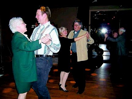 Couples dance to the tunes of the Tune Toppers during a fund-raising event at the Children's Museum recently. The photo was taken by Ed Beaton.