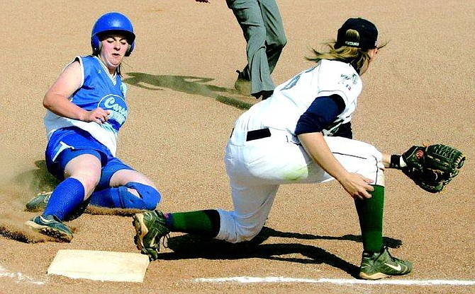 BRAD HORN/Nevada Appeal Carson's Jessica Grant slides safely into third base in the Senator's game against the Damonte Ranch Mustangs in Carson City Monday.