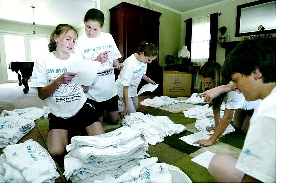 Cathleen Allison/Nevada Appeal St. Teresa of Avila students sort T-shirts Monday afternoon in preparation for the Run With the Son fund-raiser set for Friday. From left are Kellie Kerkla, Beth Lewis, Alyson Redmond, Sarah Kerkla and Jeff Lewis.