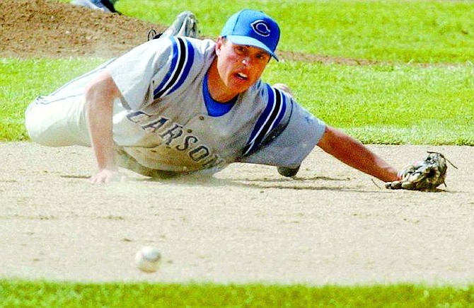 Carson High school shortstop Kevin Schlange dives for a ball hit up the middle of the infield during the Senator's game against the Douglas Tigers in Minden, Nev., on Saturday, May 7, 2005. AP Photo Brad Horn/Nevada Appeal