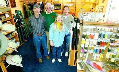 Belinda Grant/Nevada Appeal News Service Angler's Edge in Gardnerville has moved. Its employees are, left to right, Pete Bauer, Burl Middendorf and owners Liz and Don Weirauch.