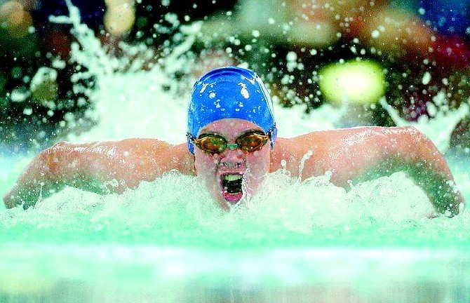 BRAD HORN/Nevada Appeal Carson High swimmer Sam Forbes competes in the 400 IM finals at the Carson Aquatic Center on Saturday.