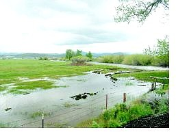 Kurt Hildebrand/Nevada Appeal News Service Floodwaters from the west fork of the Carson River inundate pastureland along Highway 88 in Centerville.