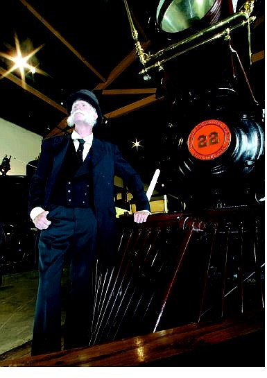 BRAD HORN/Nevada Appeal James Saylor, portraying Henry Yerington, stands next to the Inyo No. 22 at the Nevada State Railroad museum on Friday afternoon. The museum celebrates its 25th anniversary this weekend.