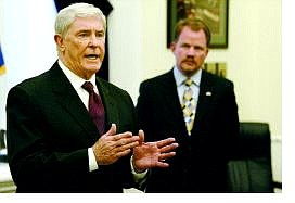 Cathleen Allison/Associated Press Gov. Kenny Guinn, left, and Chief of Staff Mike Hillerby answer media questions Monday morning at the Capitol. Guinn says the IRS gave a favorable response to his plan to give $300 million back to Nevada taxpayers through a DMV rebate.