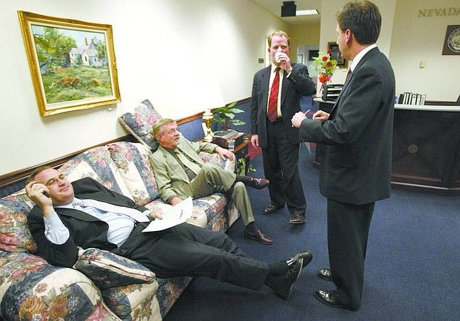 Cathleen Allison/Nevada Appeal From left, Nevada lobbyists Greg Ferraro and Fred Hillerby talk with Chief of Staff Mike Hillerby and state Treasurer Brian Krolicki just before midnight Monday at the Legislature. State lawmakers missed a 1 a.m. deadline Tuesday to finish the legislative session after talks broke down over the proposed changes to the Millennium Scholarship program. After a 10-hour special session, lawmakers were able to conclude the session.