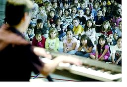 Cathleen Allison/Nevada Appeal Keyboardist Jim Martinez plays for students at Empire Elementary School Monday afternoon as part of a program to educate them about jazz music.