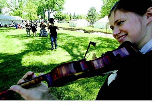 BRAD HORN/Nevada Appeal Tashina Clarridge, of Mt. Shasta, Calif., warms up for the Old Time Fiddle Contest at Mills Park during the Carson CIty Rendezvous on Saturday.