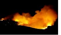 BRAD HORN/Nevada Appeal A wildfire in Pleasant Valley at 10:30 p.m. Sunday. The human caused fire that started at about 9:16 p.m. burned 30 acres.