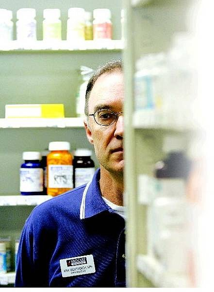 Kirk Wentworth, owner of Medcare Pharmacy, talks about the effect the newly passed legislation concerning Canadian drugs will have on his business while at his store on Friday.  BRAD HORN/Nevada Appeal