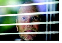 BRAD HORN/Nevada Appeal Dale Edwards, a board member for Secret Witness, looks out of his Reno home on Friday morning. Edwards, whose wife is a scool teacher, has two grown daughters.