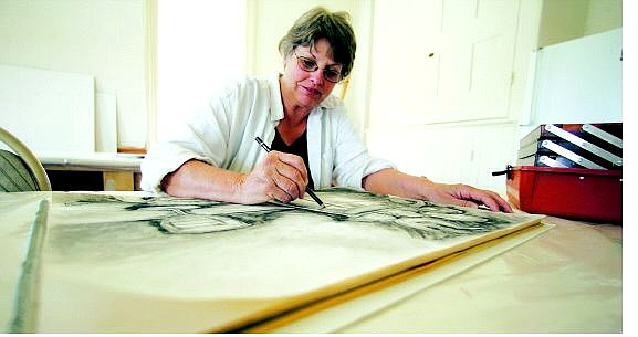 BRAD HORN/Nevada Appeal Karen Wesner, of Gold Hill, draws at St. Mary's Art Center on Wednesday.
