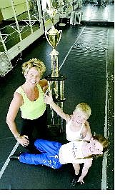 Gina Kaskie Davis poses with two of her students, Ryan Vettel, 8, and Danika Hill, 7, after they won awards at the Dance USA Nationals in Las Vegas last week.   Cathleen Allison Nevada Appeal