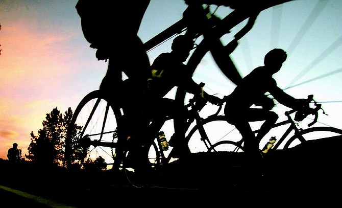 Cyclists climb out of Markleeville, Calif., at 4:45 a.m., on Saturday, July 9, 2005, at the beginning of the Death Ride. The 128.5 mile ride lures riders the more than 2700 riders over 5 mountain passes in the Sierra Nevada mountain range. AP Photo Brad Horn/Nevada Appeal.