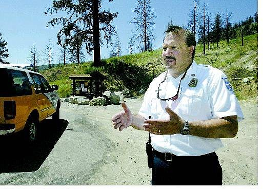Cathleen Allison/Nevada Appeal Carson City Fire Chief Stacey Giomi talks about the Waterfall fire from the top of Kings Canyon Road on Wednesday.