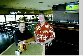 Cathleen Allison/Nevada Appeal Business partners Nate Lance, left, and Damon George have opened Mulligan's restaurant and sports pub in the old Tequila Dan's building on Highway 50.