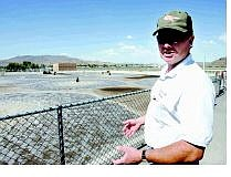 Chad Lundquist/Nevada Appeal Wastewater Operations Supervisor Fred Howard checks on one of the secondary-treatment ponds at the waste water reclamation plant on Wednesday afternoon.