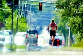 Brad Horn/Nevada Appeal Rob Robinson, of Carson City, runs up Fifth Street on Thursday afternoon. Temperatures continue to stretch in the high 90s and forecasters expect little change for the rest of the week.