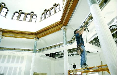Cathleen Allison/Nevada Appeal Ed Packard, with Central Sierra Construction, works on finish carpentry in the historic Capitol Annex Building Tuesday morning.