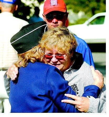 JoAnn Hyde is comforted by Marjorie Sieber, 74, of Carson City, while Hyde's grandson Trent Rossman, 16, watches. Friends and family gathered Friday at the Korean War Veterans Memorial Park to pay tribute to Richard Hyde, who inspired the park.   BRAD HORN Nevada Appeal