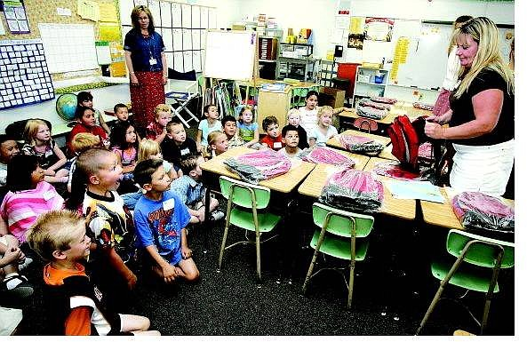 Chad Lundquist/Nevada Appeal After returning from a 3 week vacation, first grade students from Fremont elementary received free backpacks from Costco on Monday.