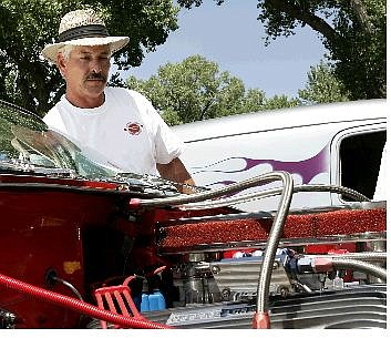 Chad Lundquist/Nevada Appeal  Left: Randy Tippit, next to his 1960 Chevy Impala, at the Silver Dollar Car Classic at Mills Park on Sunday. Tippits car won the Warren Engine Company Volunteer Fire Department Award. Above: The chrome was well polished on this 1933 Ford Coupe owned by Byron Hisey of Newman, Calif. the coupe won the People's Choice award at the show.