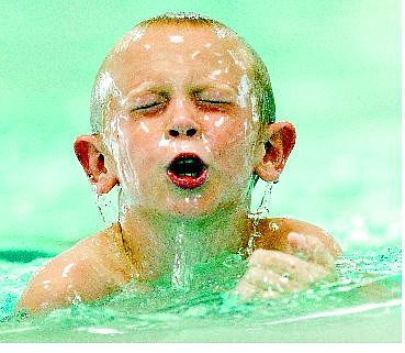 BRAD HORN/Nevada Appeal Joshua Keith, 8, of Carson City, competes in the swimming portion of the second annual Capital Kids Triathlon at Mills Park on Saturday.