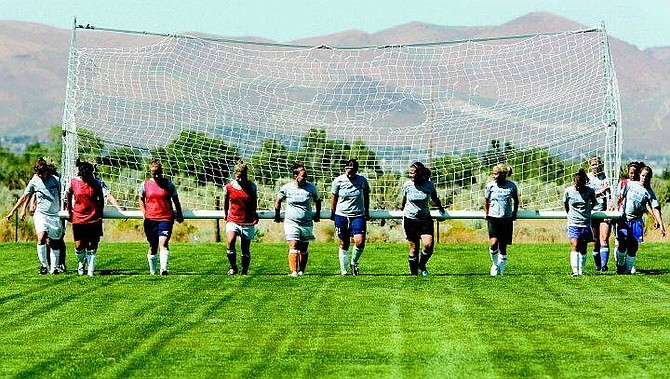 Chad Lundquist/Nevada Appeal The women's soccer team from Western Nevada Community College, moves the goal for practice on Tuesday, at Edmonds Sport Complex. The WNCC Women's Soccer team host its first home game on September 1st.