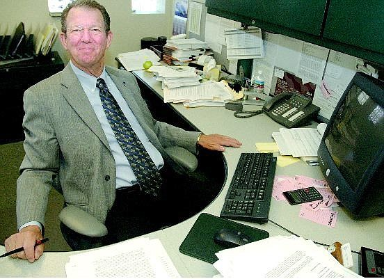 Kevin Clifford/Nevada Appeal Chuck Chinnock, Department of Taxation director, poses at his desk Friday.