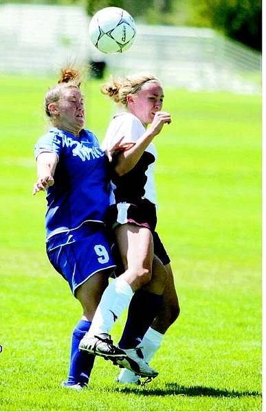 BRAD HORN/Nevada Appeal Melissa Foldfin fights for the ball against a Northern Idaho Cardinal during the first half at Edmonds Sports Complex on Saturday.