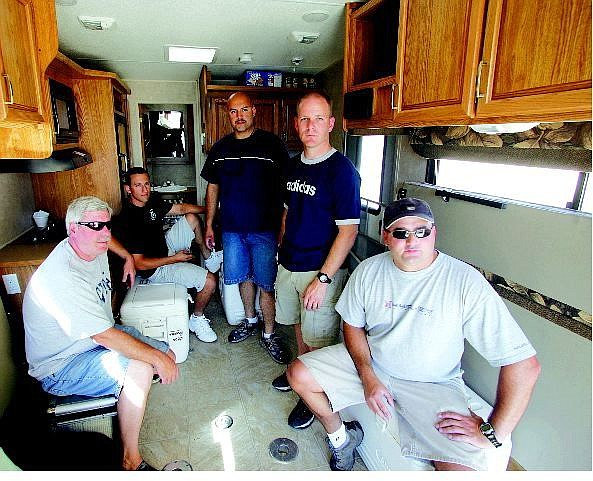 BRAD HORN/Nevada Appeal Carson City Undersheriff Steve Albertson, from left clockwise, deputies Cody Della Bitta, Jose, Gomez, Don Gibson and Dan Ochsenschlager, sit in the trailer they will be living in before their departure to the Gulf Coast.