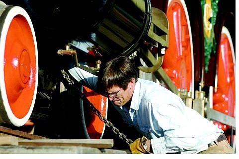 BRAD HORN/Nevada Appeal Chris DeWitt, supervisor of restorations for the Nevada State Railroad Museum, cinches down the V&T railroad engine No. 18, the Dayton, at the Comstock History Center in Virginia City.