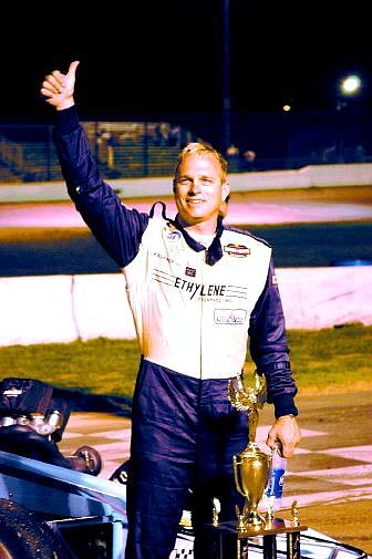 Troy Regier, driver of the S&S Motorsports supermodified, gives a thumbs up to the crowd after winning the annual Harvest Classic at Madera Speedway in Madera, Calif. Saturday night. Regier also won the 2005 championship for the Supermodified Racing League. Photo by Jack Rhyne