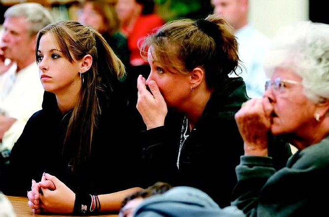 """Chad Lundquist/Nevada Appeal Lisa Brooks, 38, center, reacts to a video about methamphetamine abuse on Tuesday night during the first of a three seminars entitled """"Get the Facts about Methamphetamine."""" About 25 people attended the seminar at Bordewich/Bray Elementary School, including Brook's daughter Susan, 13, left, and her mother Lucy Garman, right."""
