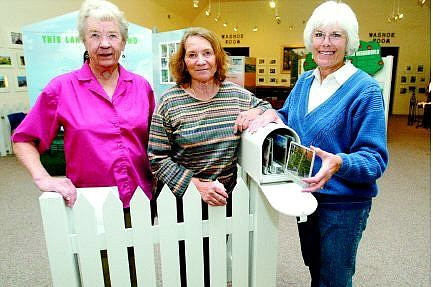 "Belinda Grant/Nevada Appeal News Service Irene Marshall, Laurie Hickey and Betty Cordes of the Carson Valley Historic Society with a part of the ""Between Fences"" exhibit at the Cultural Center on display until Oct. 23."