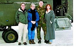 Submitted photo The Stewart family stands by a Chinook helicopter prior to Sgt. Patrick Stewart's deployment to Afghanistan. Pictured, from left, are Steve, Sandy, Patrick and Roberta Stewart.